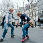 Two young «security» members having fun on their rollerblades