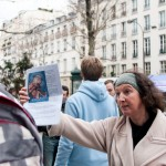 Pro-life showing an embryo picture to pro-abortion